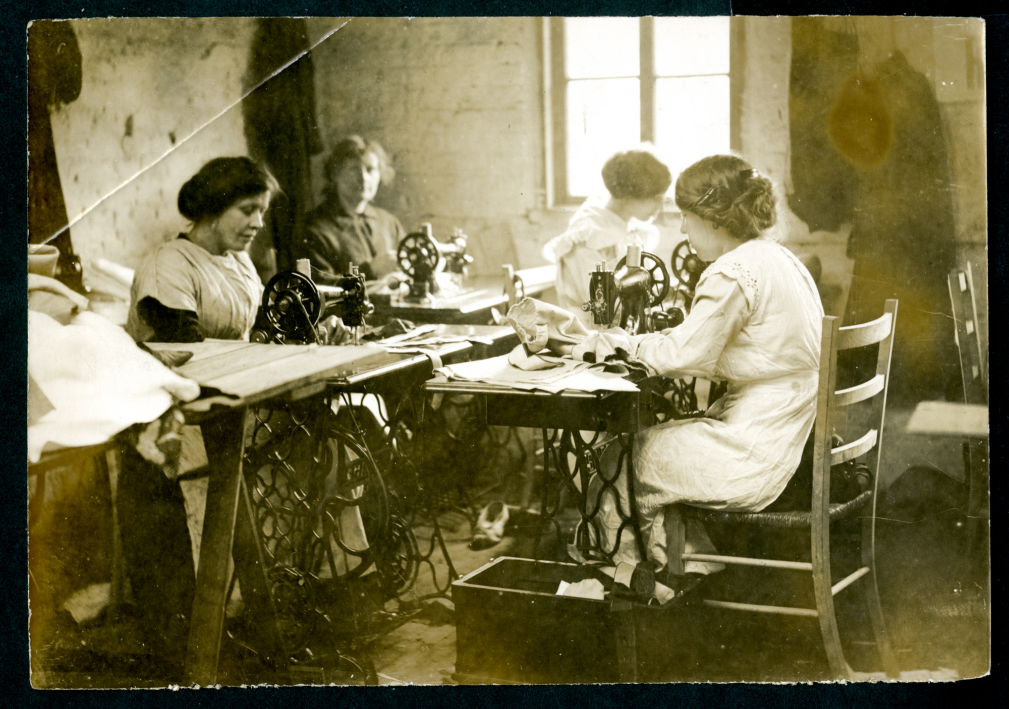 Four women working on sewing machines in the ELFS cooperative factory