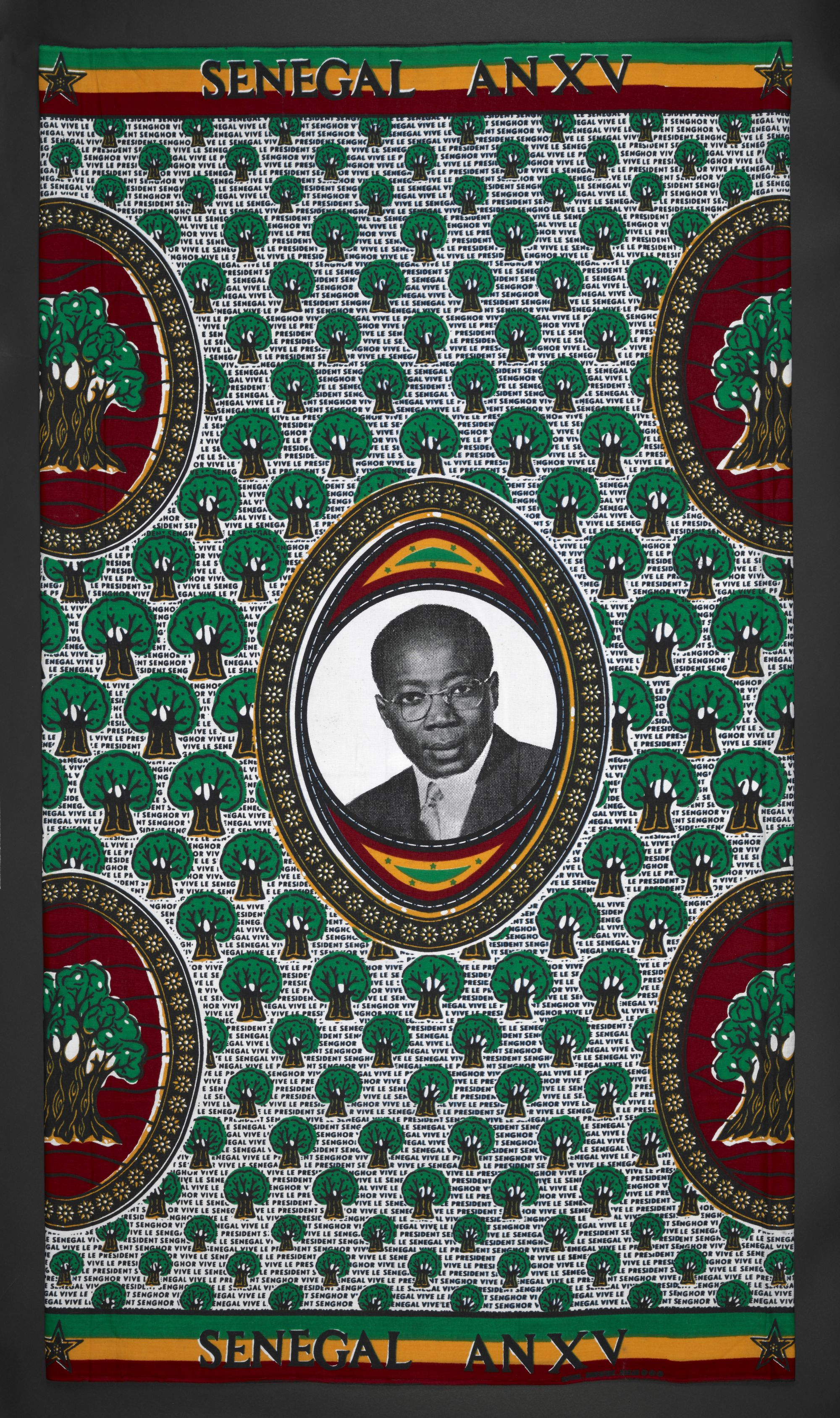 A printed cloth marking 15 years of Senegal's independence in 1975. It shows Léopold Sédar Senghor (1906–2001), the Senegalese intellectual, poet, politician and president (1960–80).