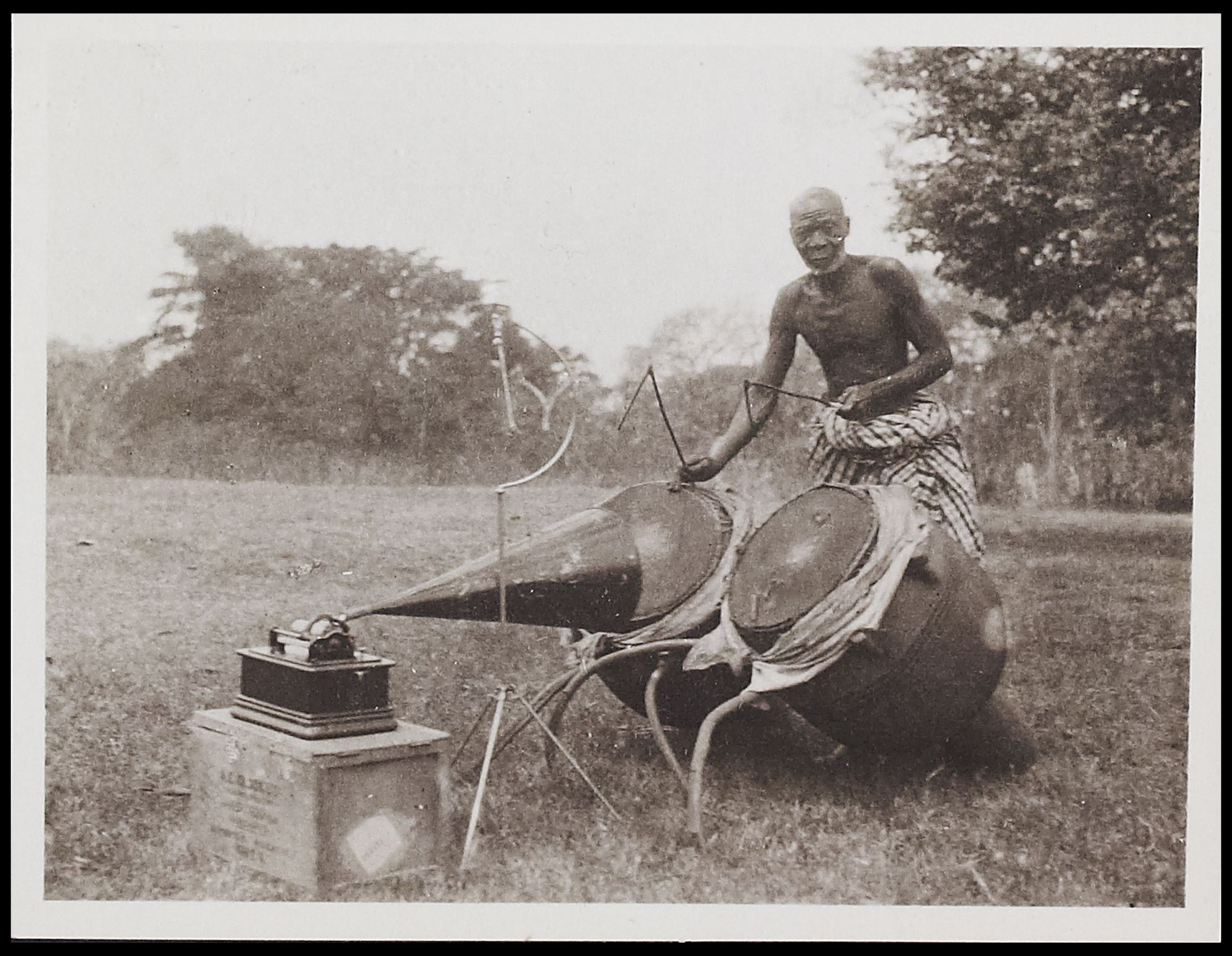This picture shows Kofi Jatto performing phrases of text on the Asante atumpan drums in Ghana in 1921.