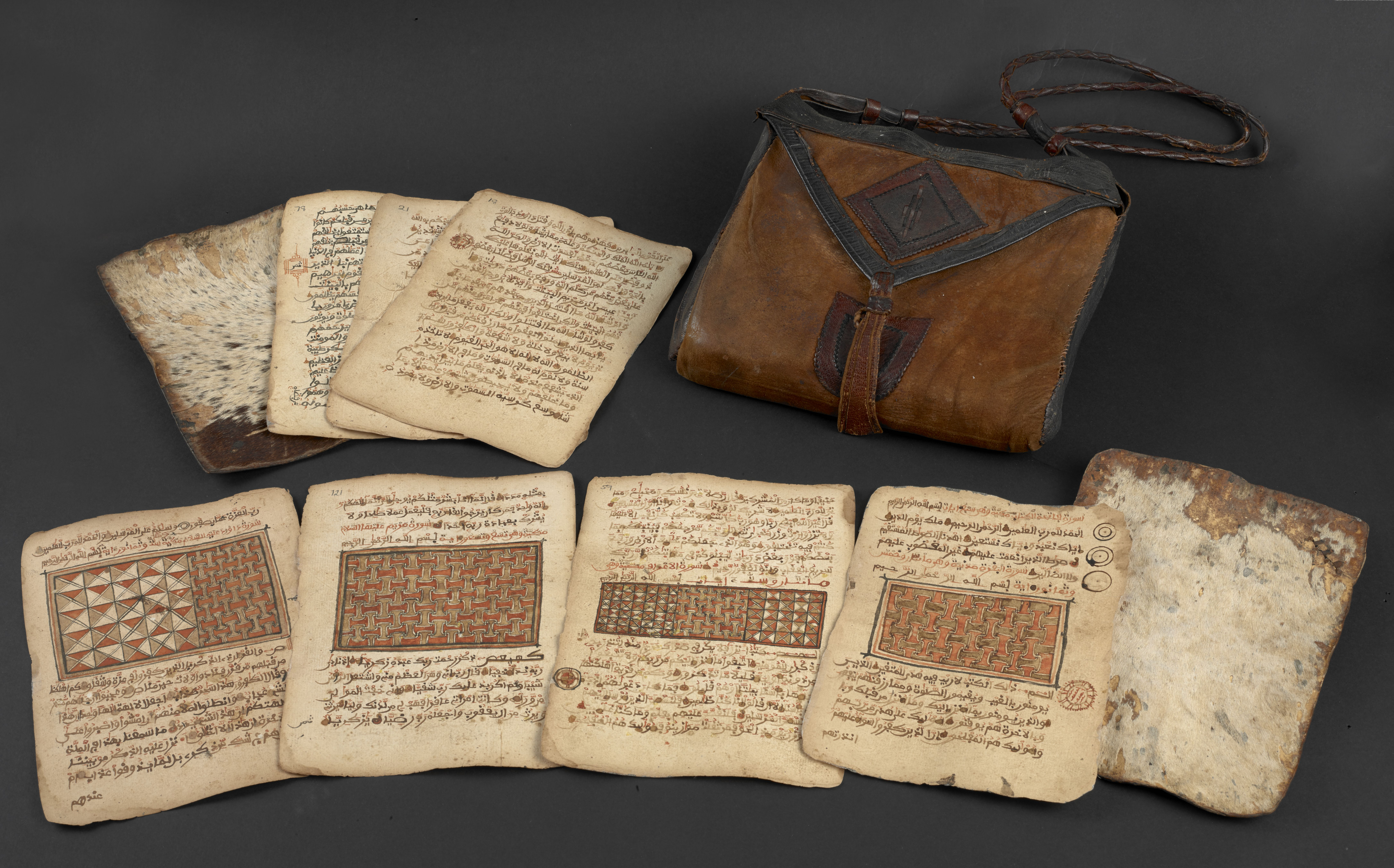Looseleaf, illuminated Qur'an, together with its original leather bag from northern Nigeria/southern Niger/Chad