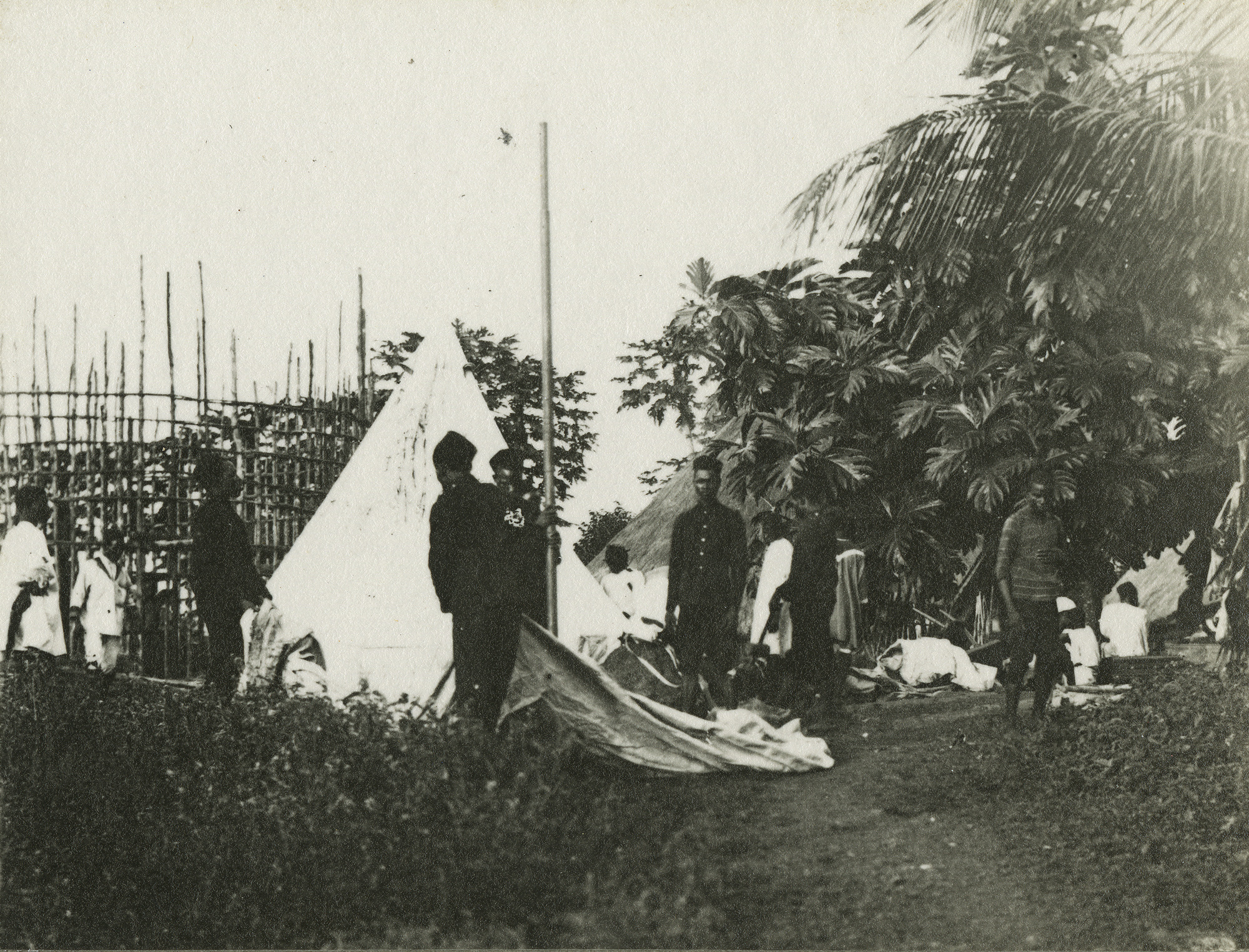 Folio 19, Photo #3 Pitching tents and preparing camp.