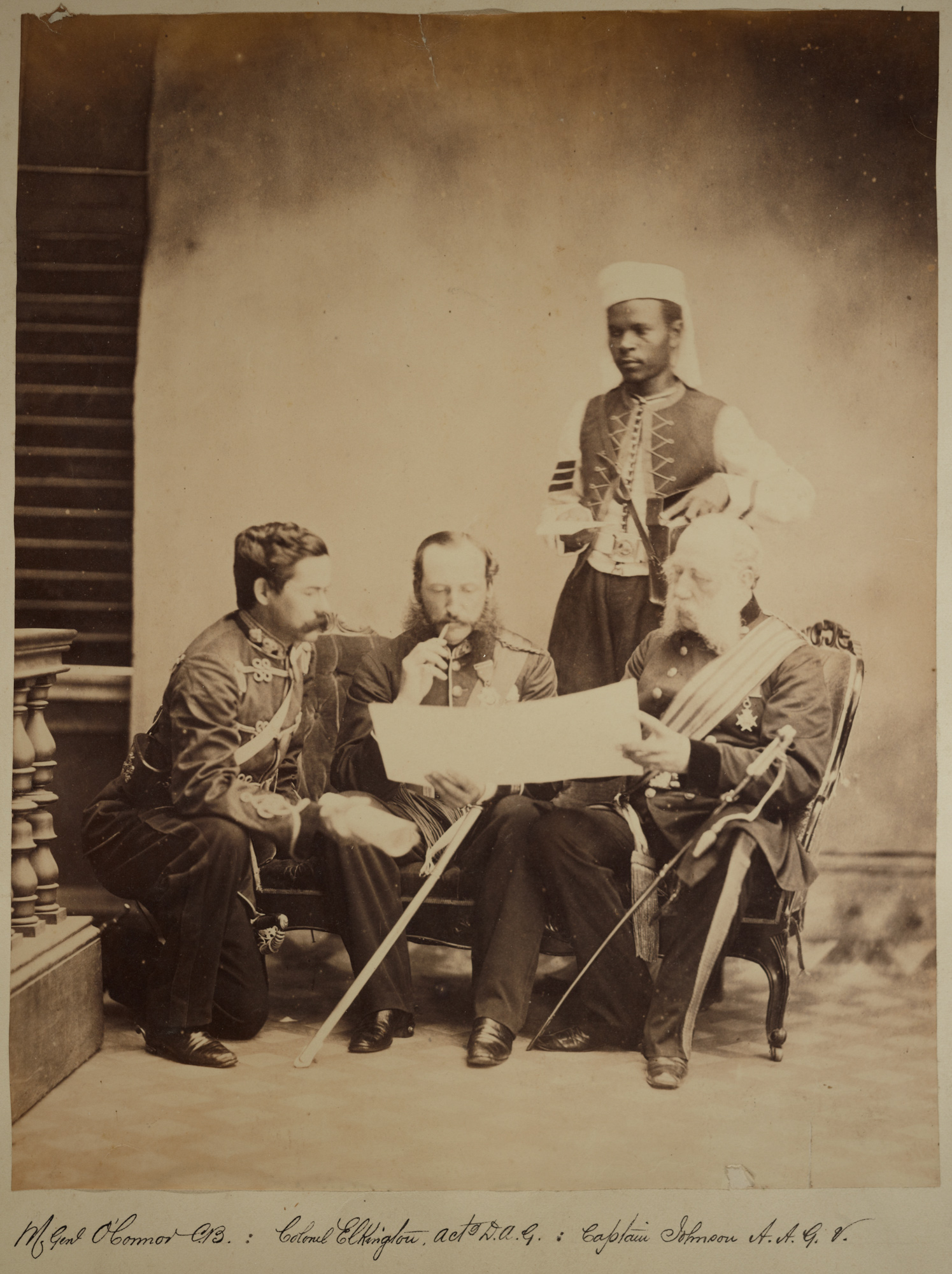 Photograph of three white British officers from the 1st West India Regiment