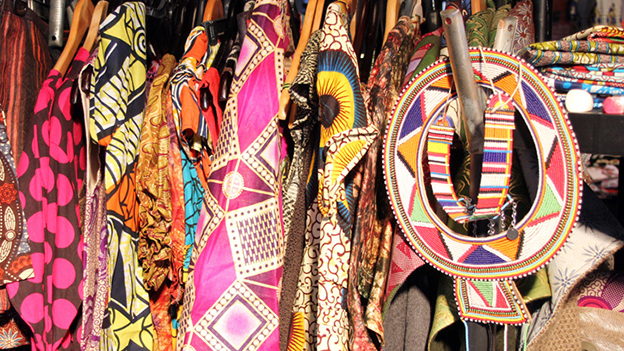 Traditional colourful clothing on an African market stall