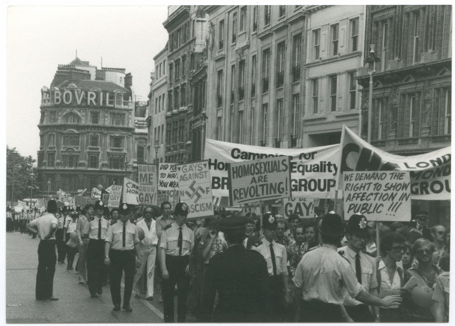 Marchers, banners and police at Gay Pride march, London, 1974. Photo credit: LSE Library