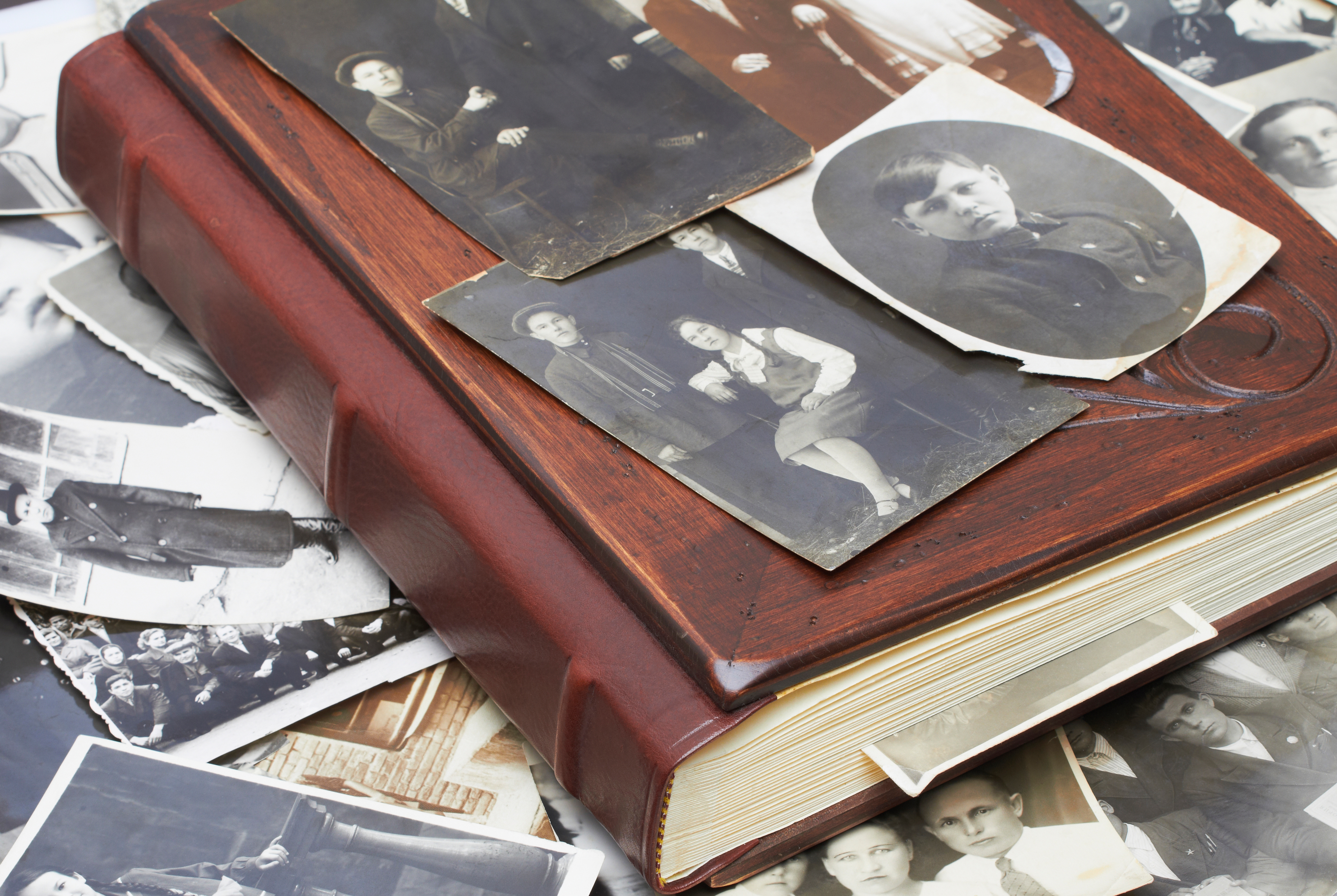 Leather and wood photo album, with black and white photographs.
