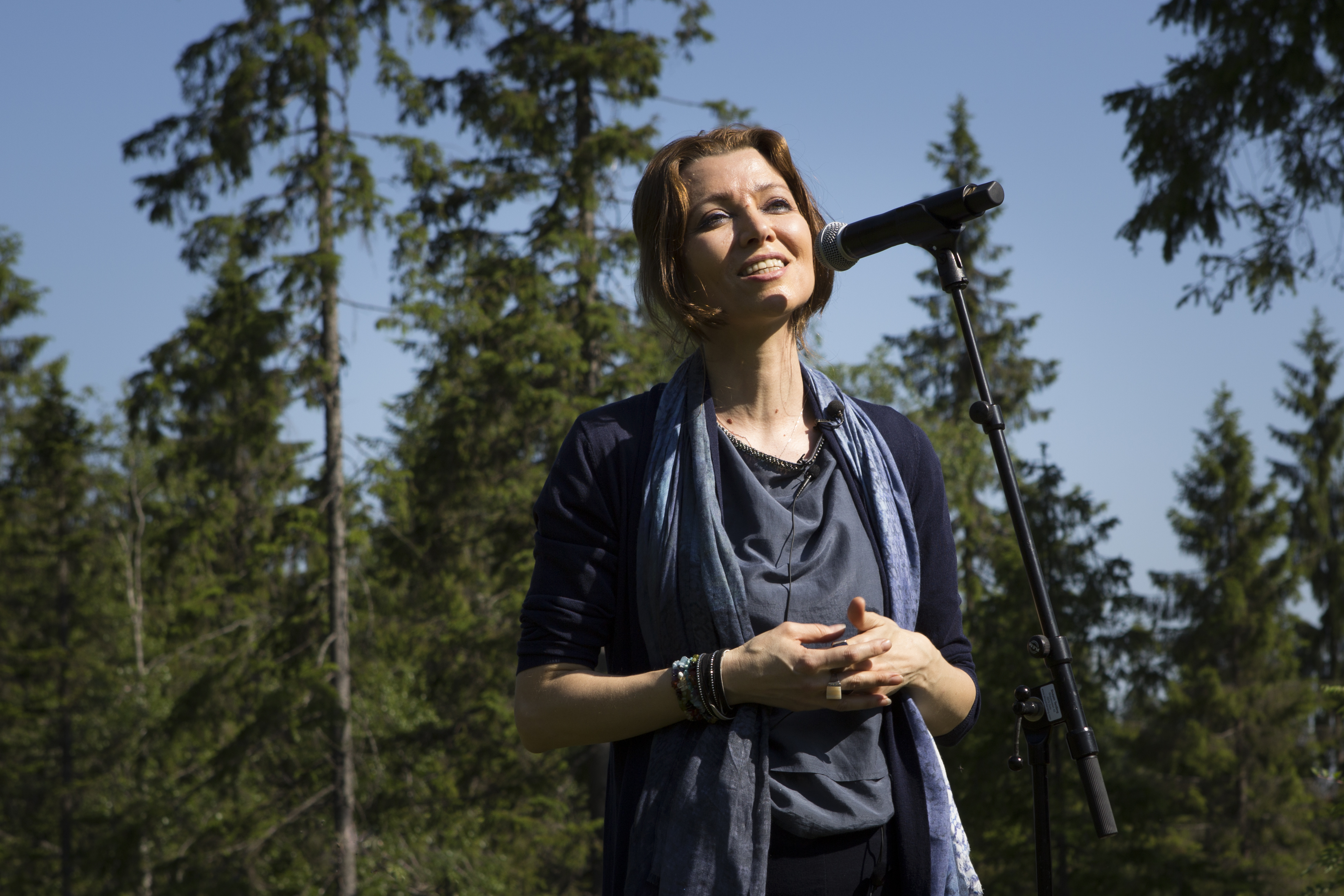 A photograph of the writer Elif Shafak at Future Library Handover Day, pictured outside in a forest