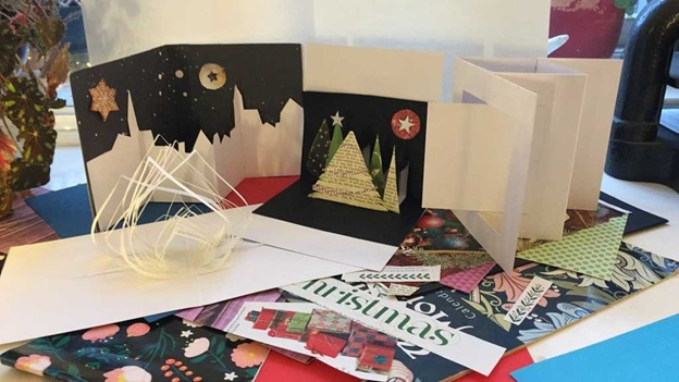 Selection of hand-made Christmas cards and decorations.