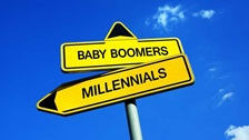 "Yellow signpost with signs stating ""Baby Boomers"" and ""Millennials"""