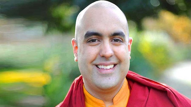 A photograph of Buddhist monk Gelong Thubten, smiling straight at the camera