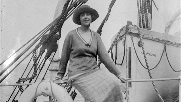 Agatha Christie posing in front of a ship