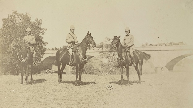 Three soldiers on horseback.