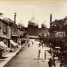 An old black and white photograph of a street behind the Jama Masjid
