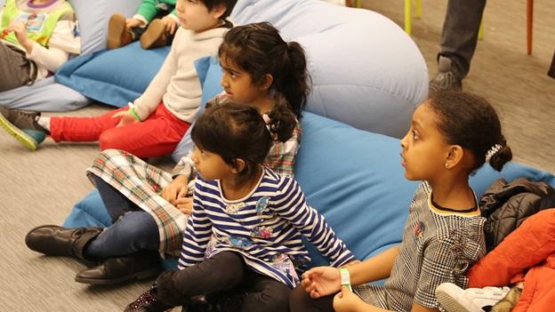 Photograph of children listening