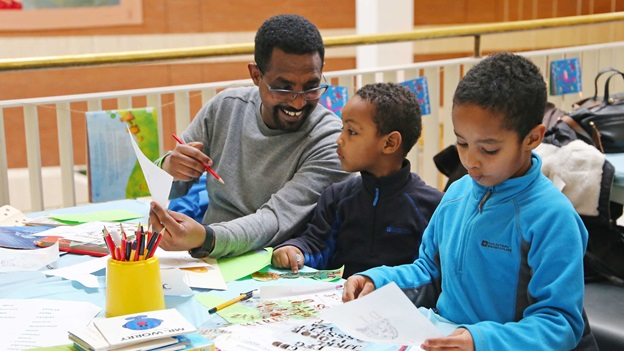 A family doing art activities in the British Library