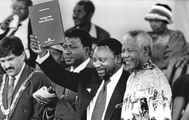 Nelson Mandela with the South African Constitution