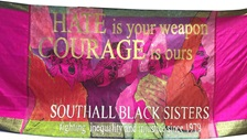 A protest banner which reads 'Hate is your weapon. Courage is ours.' Designed by Shakila Taranum Maan and kindly loaned by Southall Black Sisters