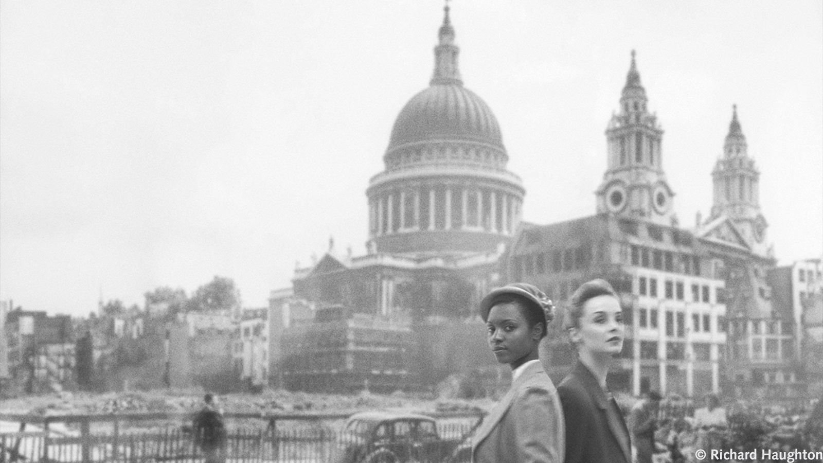 Banner image for article by Hannah Lowe about Andrea Levy's Small Island. Showing two women outside photoshopped war-torn St Paul's Cathedral.