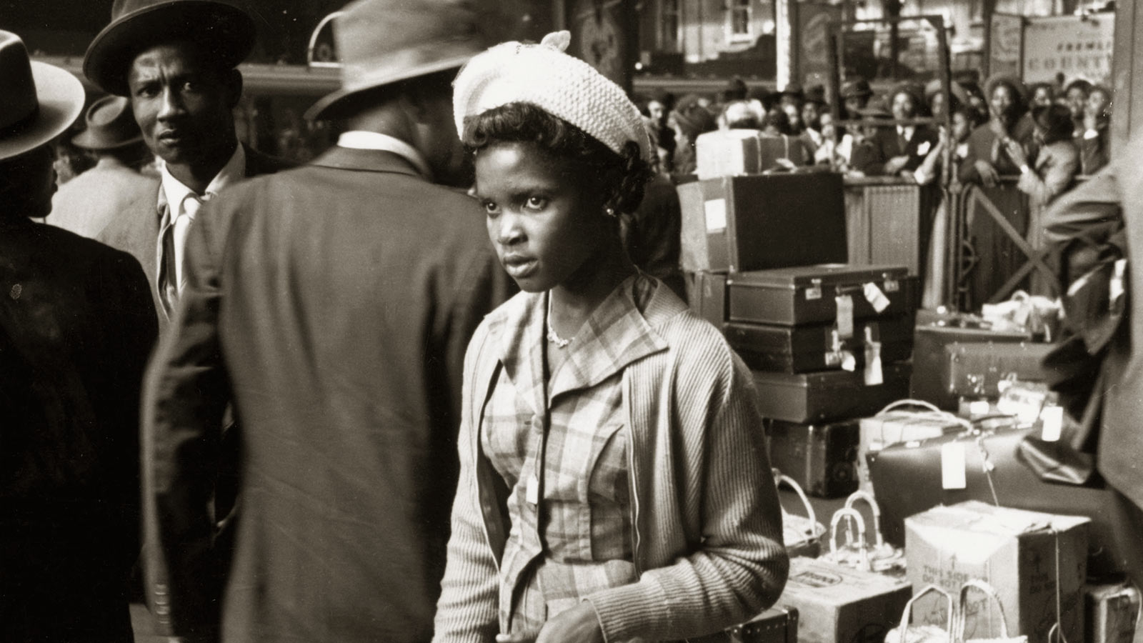 Windrush Stories homepage; photograph showing people arriving at London's Victoria Station from the Carribean via Southampton