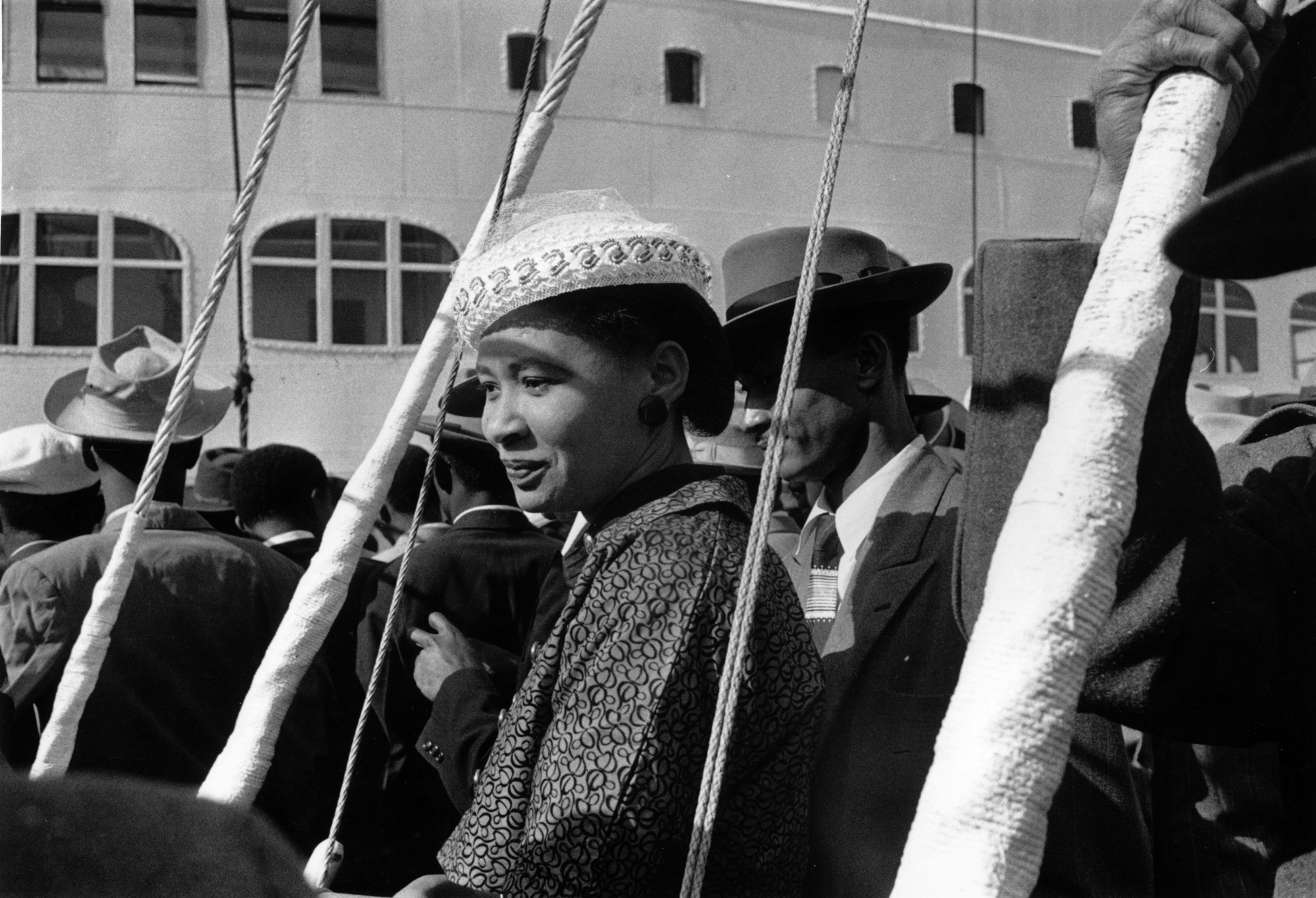 Black and white photograph of a woman arriving from the West Indies, May 1956