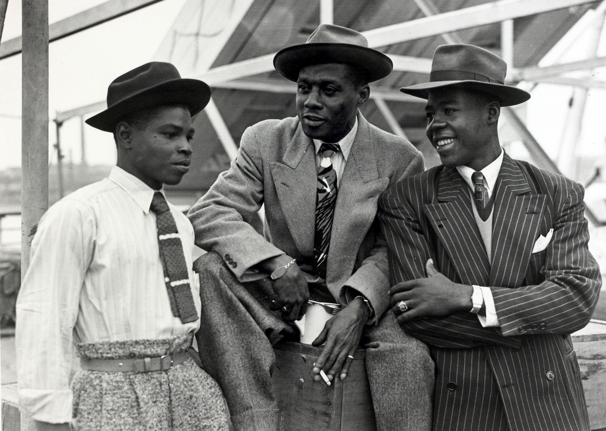 Black and white photograph of three men at Tilbury Docks, June 1948