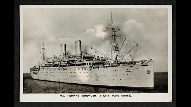 Postcard featuring a black and white photograph of the Empire Windrush ship at sea, with the text MV Empire Windrush 14,414 tons gross