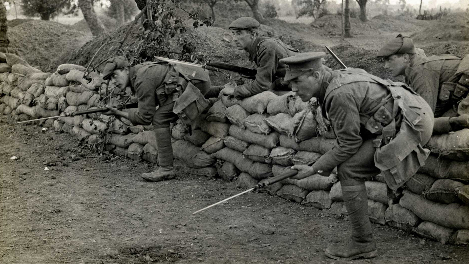 Four men leaving a trench banner