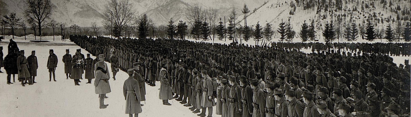 In snowy surroundings a regiment is being addressed by their leader.