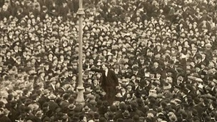 Photograph of large crowd gathered in a square