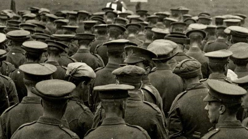 Photograph of the backs of a group of soldiers