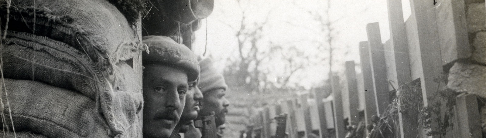 Photograph of men sat in a trench
