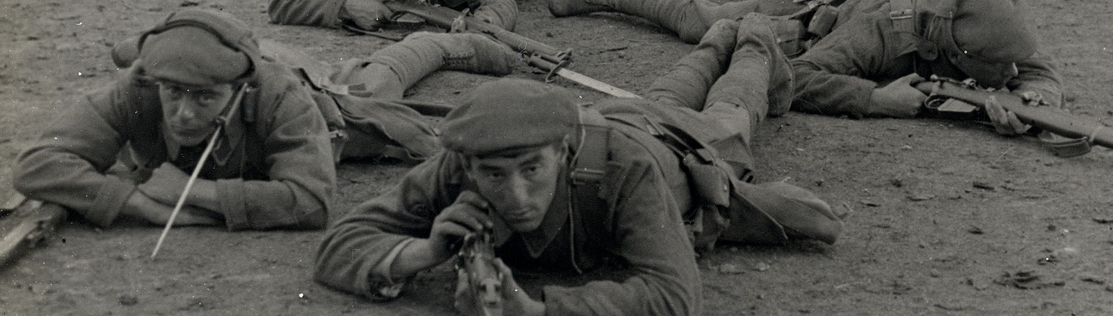 Soldiers laying on floor with rifles