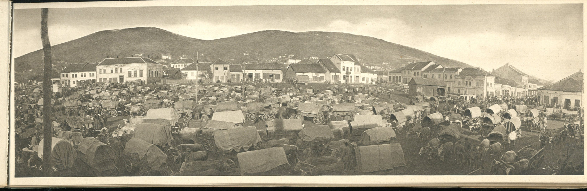 Following the fall of the Serbian capital Nish in  1915, the Serbian army retreated towards the Albanian coast. This photograph shows the army passing through a checkpoint in the town of Prokuplje.