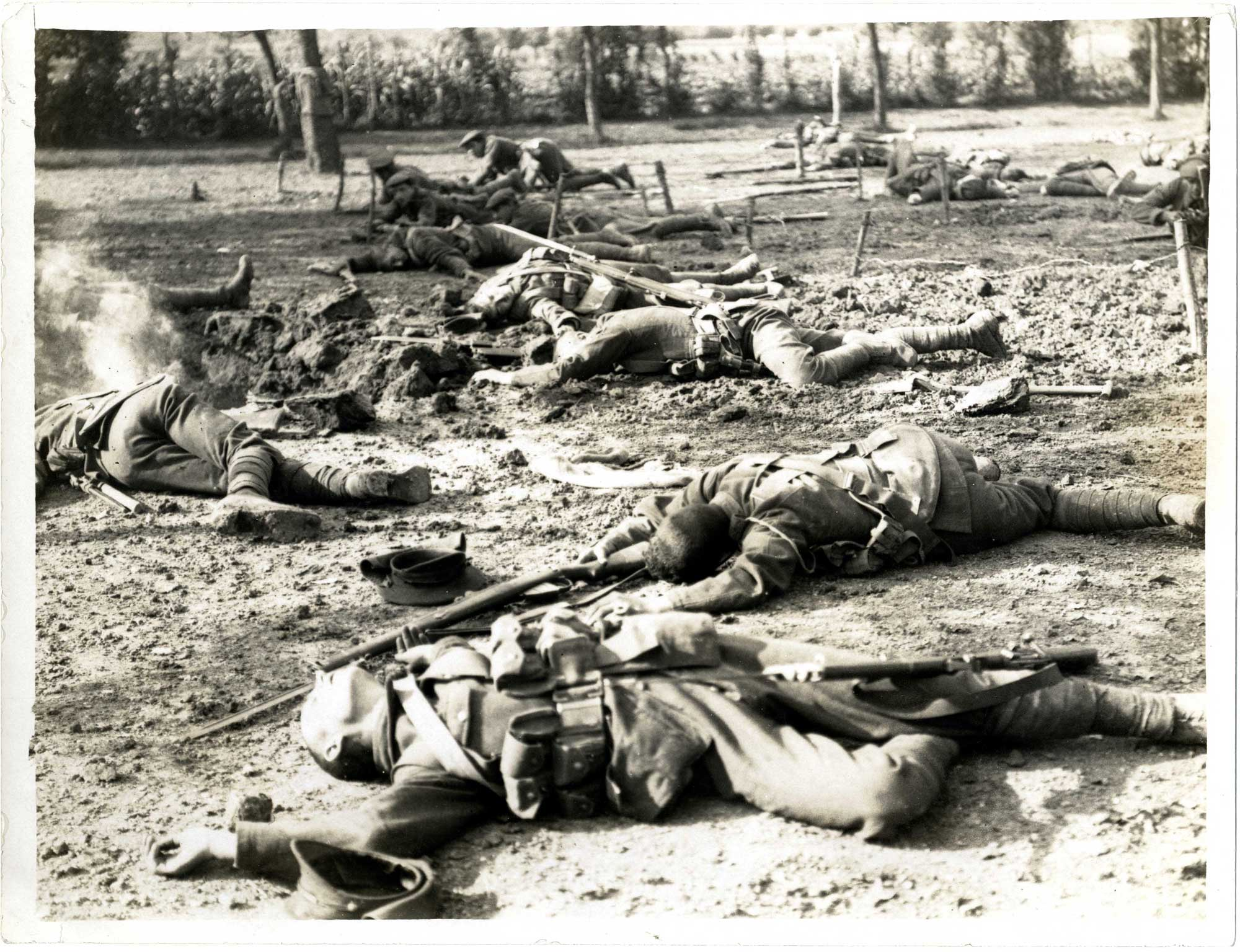 This photograph from 1915, by Canadian-born photographer Charles Hilton DeWitt Girdwood (1878-1964), shows injured and killed soldiers lying in a field after charging. It is not clear whether this is a staged photo or not.