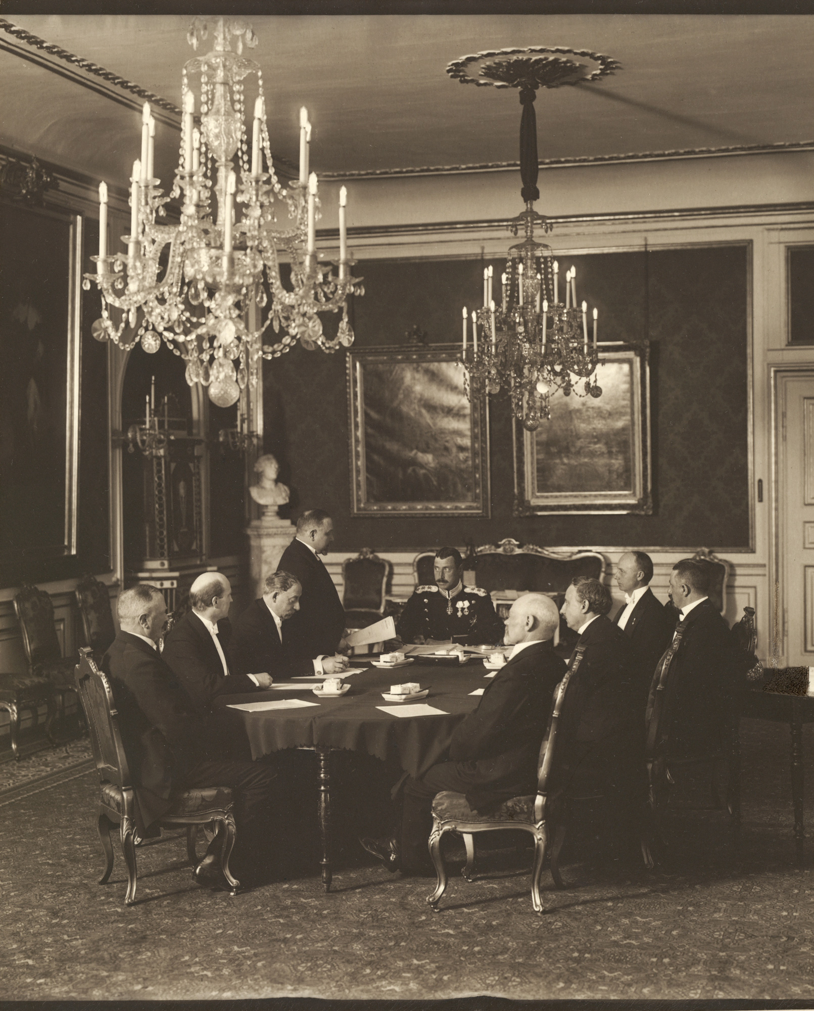 King Christian X signs the revised constitution of 1915
