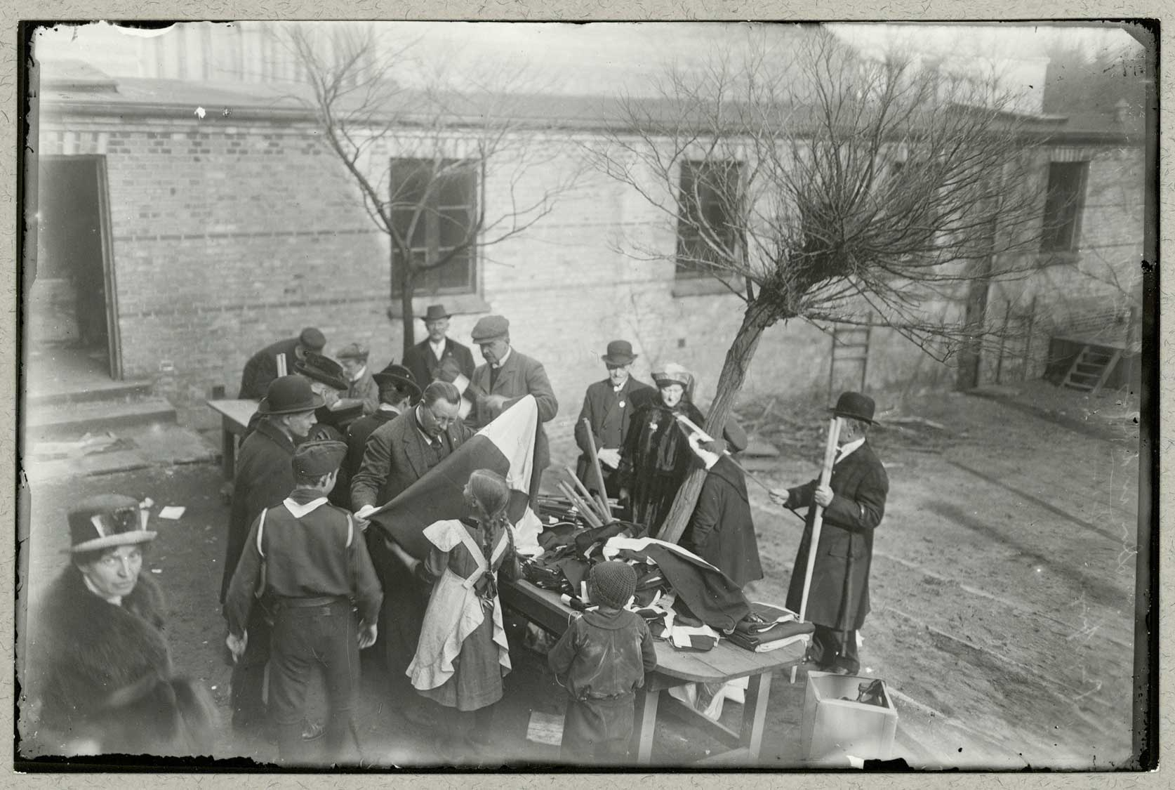 Photograph showing the distribution of Danish flags to people in the city of Flensburg during the days running up to a referendum on 20 March 1920. They were voting for either German or Danish rule, and 75% voted in favour of German.