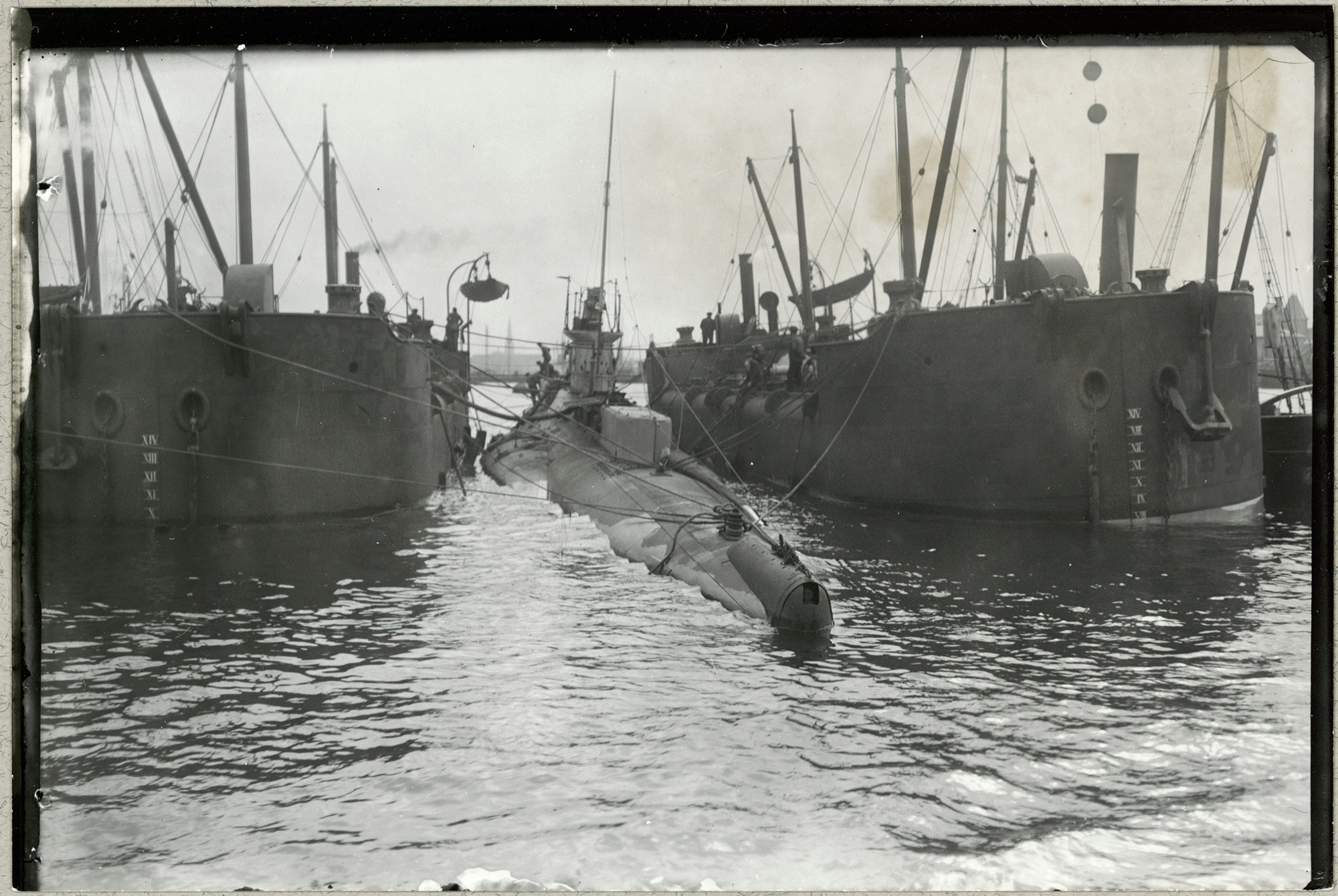 Photo of the English submarine E.13 being towed after being destroyed by German torpedo boats on Danish territory