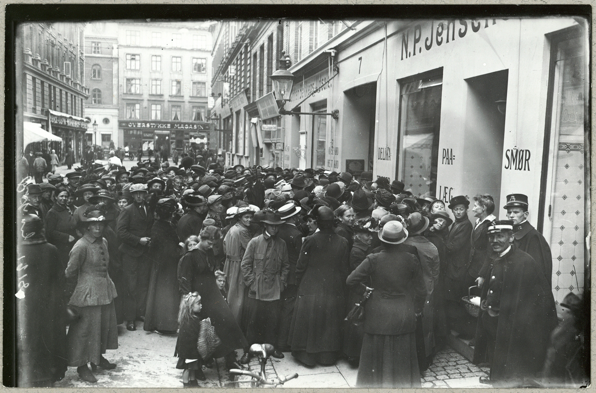Photograph showing a crowd queuing outside a butcher's in the working-class district of Nørrebro in Copenhagen.