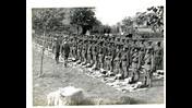 Photograph of the 1st battalion of the 4th Ghurkha Rifles lined up for kit inspection, in Flanders, Belgium, 1915.