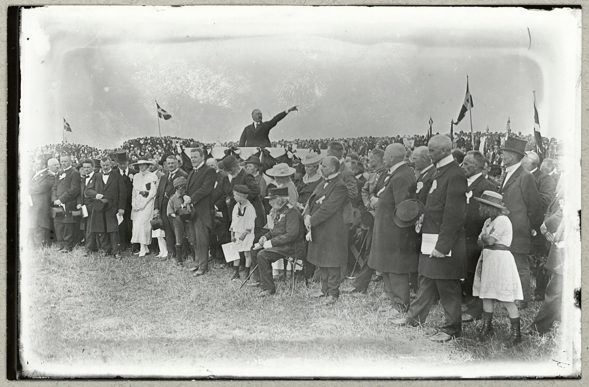 H P Hanssen speaks at a Reunification celebration