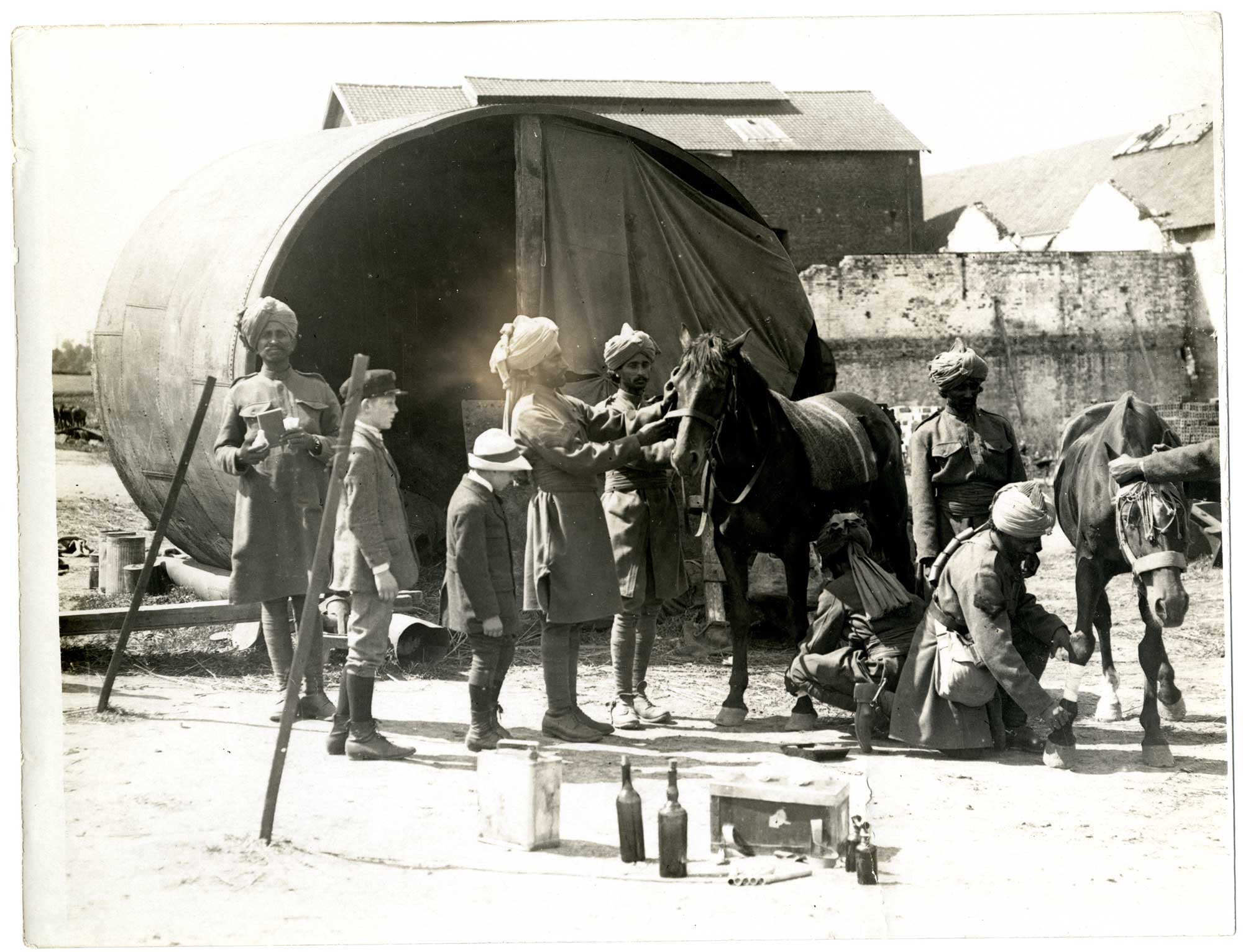 An Indian cavalry horse hospital in a French factory [Estrée Blanche], 1915. One of hundreds of photographs recording the contribution of Indian soldiers to the Allied war effort.