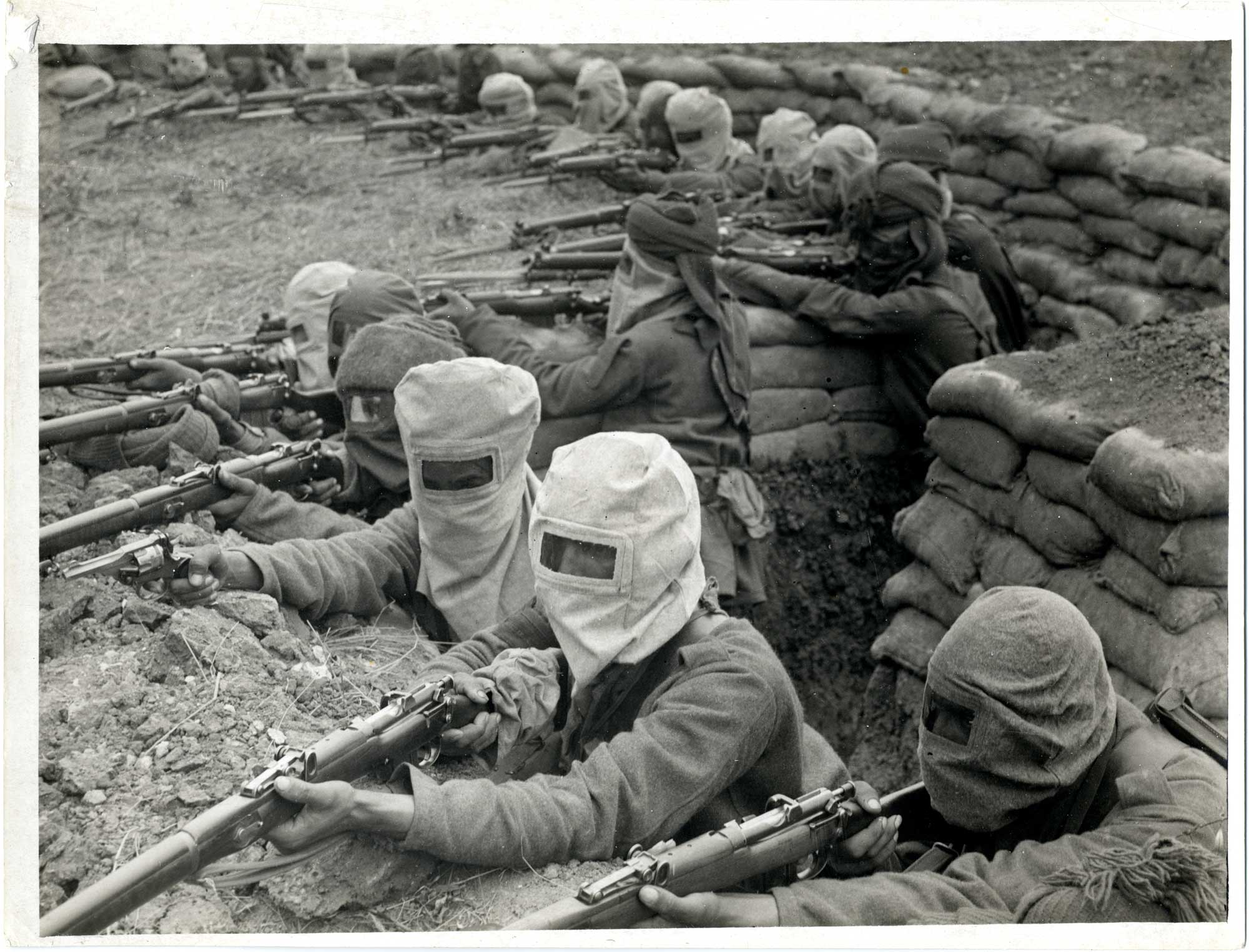 Indian infantrymen training for receiving a gas attack, 1915.