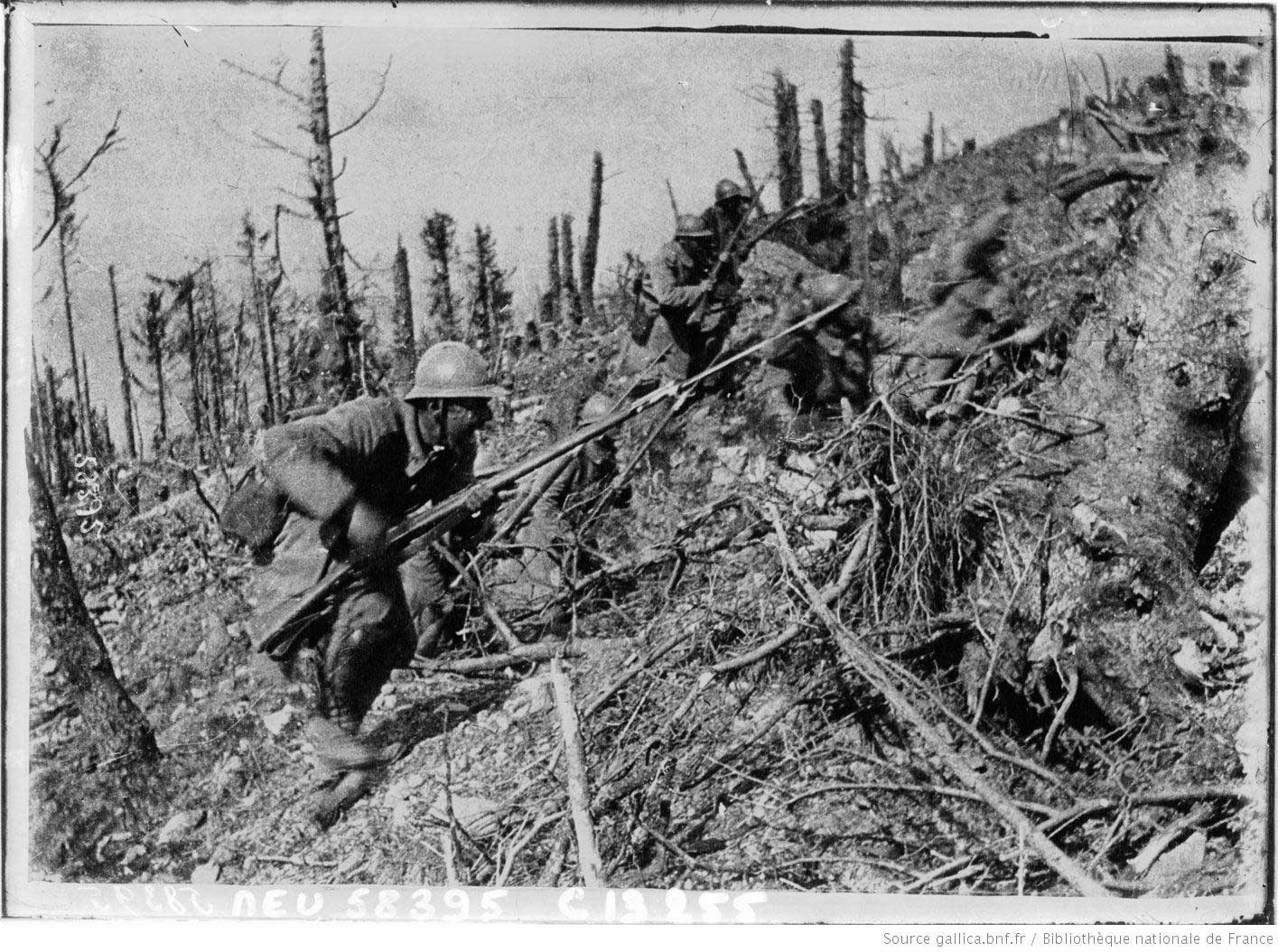 French infantry charging in Argonne, October 1915, equipped with the new Adrian helmet and the Lebel rifle with fixed bayonets.