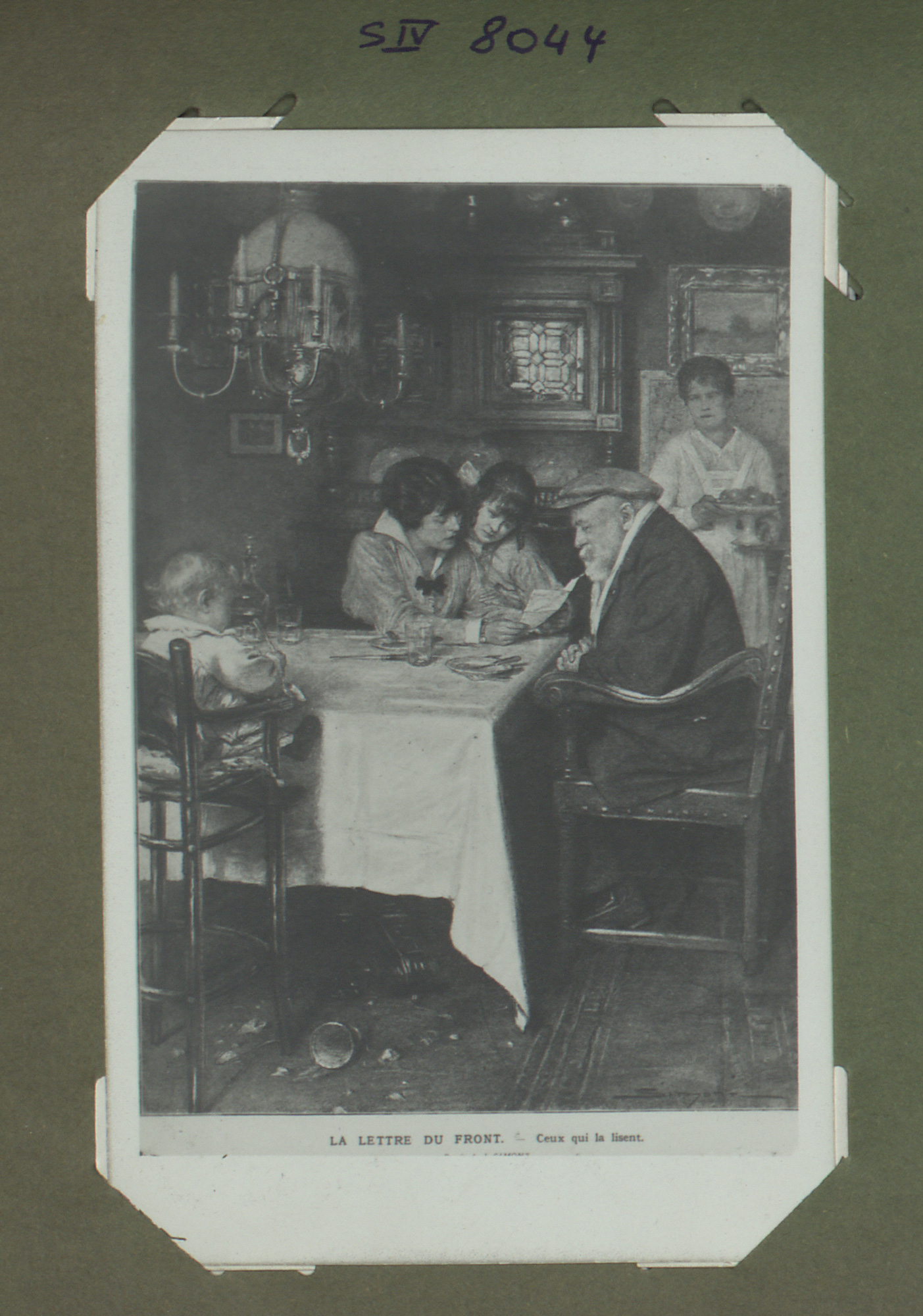 War postcard showing a family reading a letter from their son, husband and father.