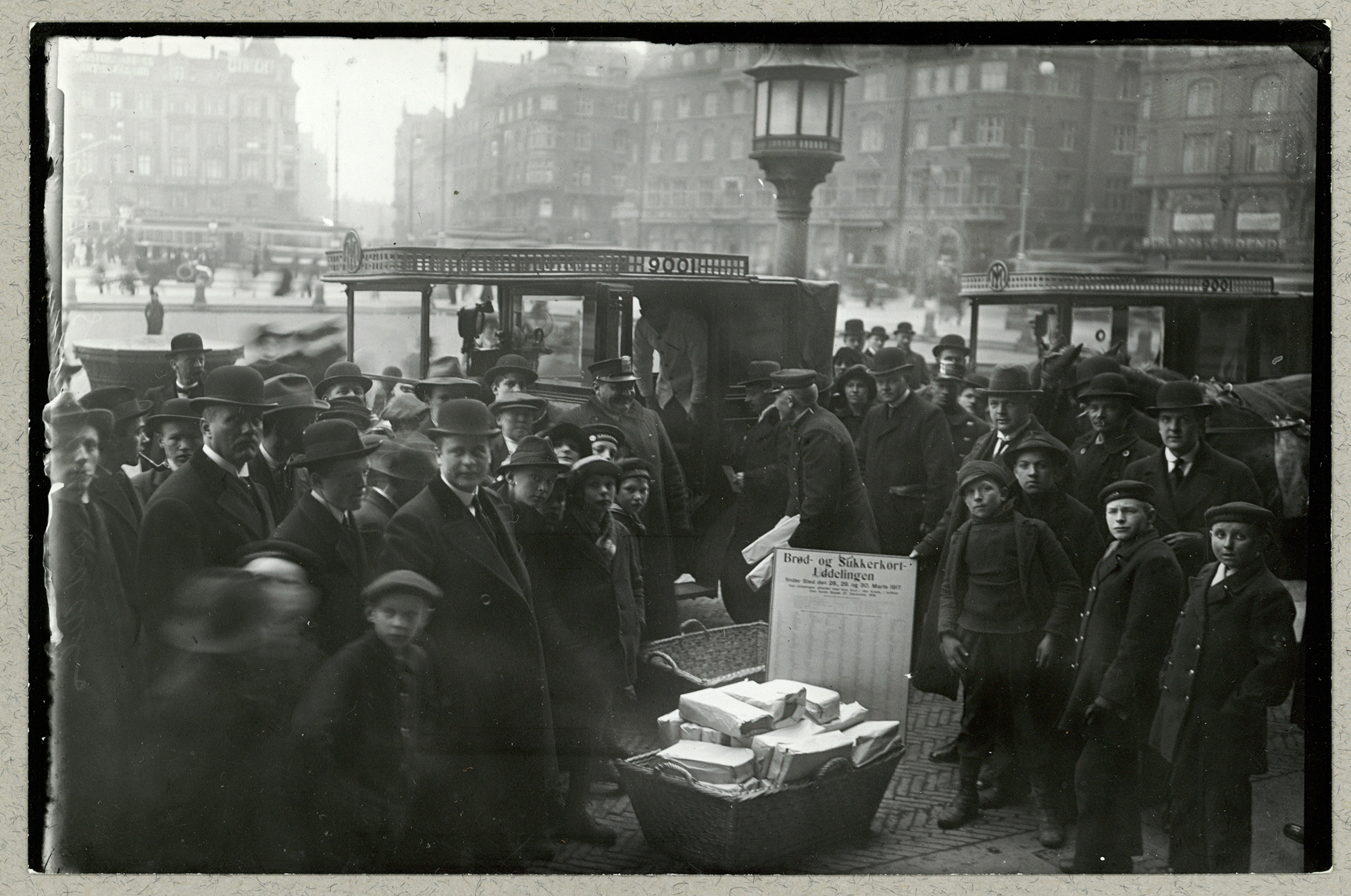 This photograph shows a queue for food ration stamps in the square of Rådhuspladsen, Copenhagen, March 1917.