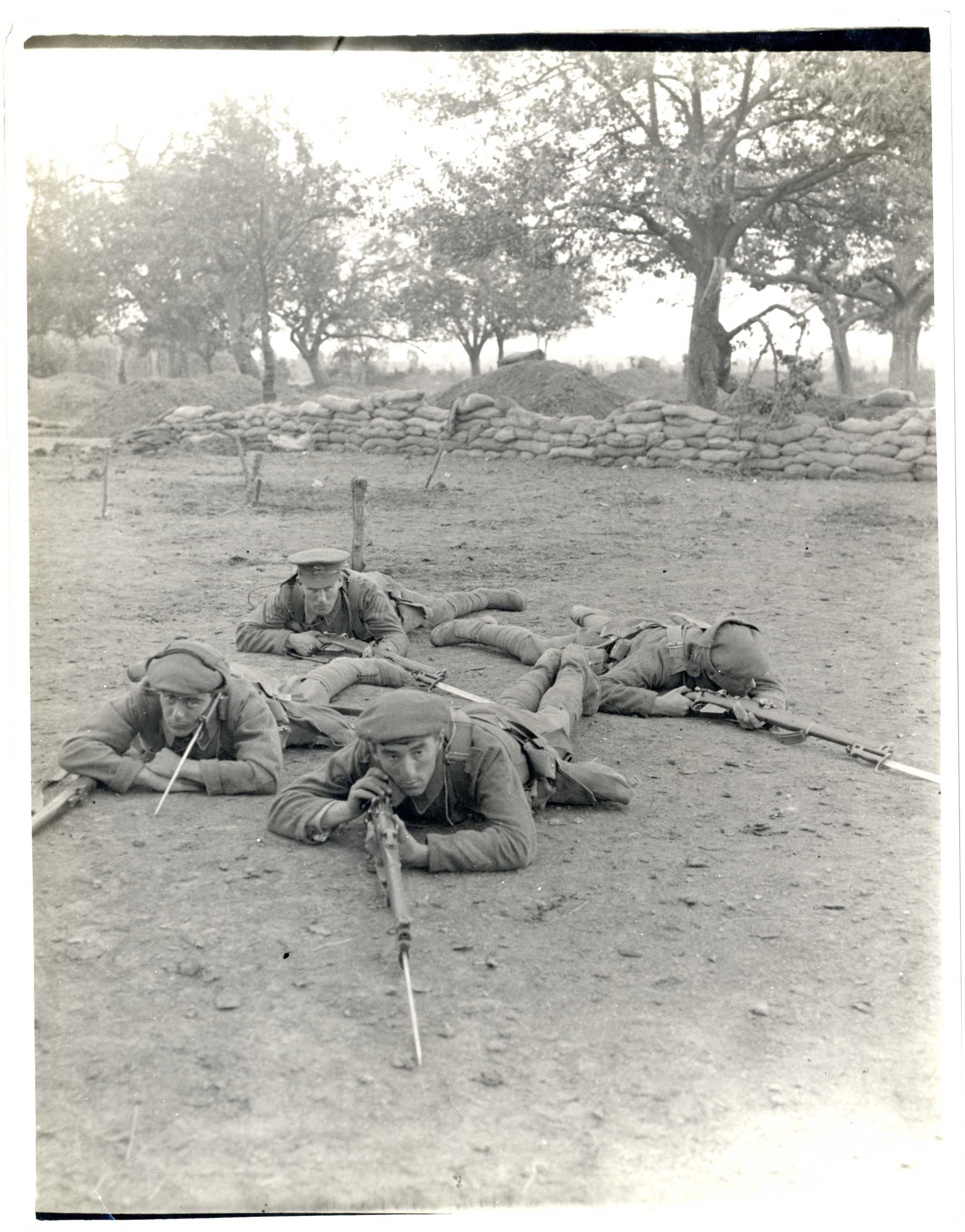 A photograph of soldiers operating as a 'listening post', dating from 1914-15. It is likely this is a training exercise.