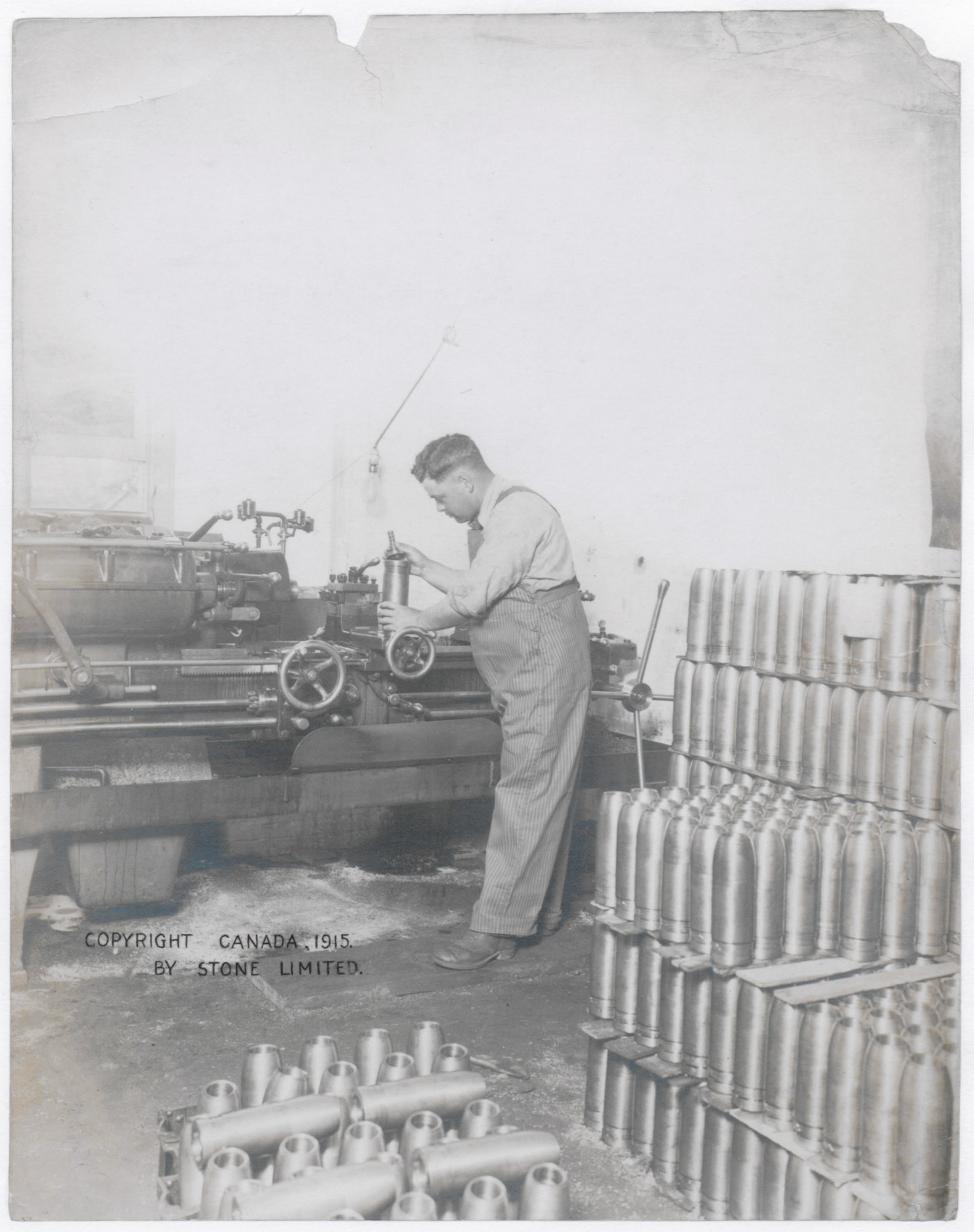 Man making shells for the war effort, from Stone Limited