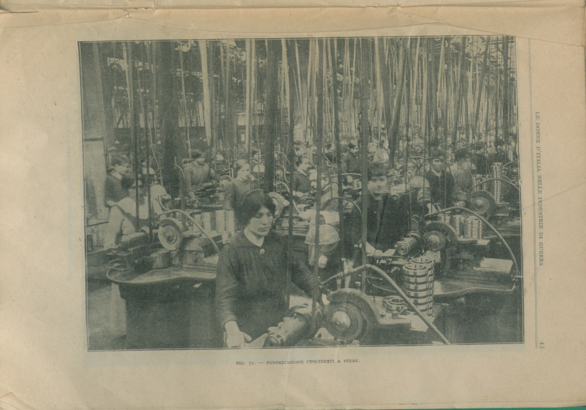 Photograph of women working in a large ball bearings factory in Italy. Published in 'Le Donne d'Italia Nelle Industrie di Guerra' ('The Contribution of Women to the War Industry').