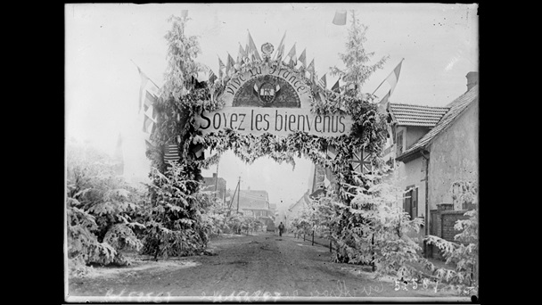 Photograph taken in December 1918 showing the Allies' flags on an entrance gate in Alsace. Alsace-Lorraine formed part of the territory lost by Germany following the Treaty of Versailles.