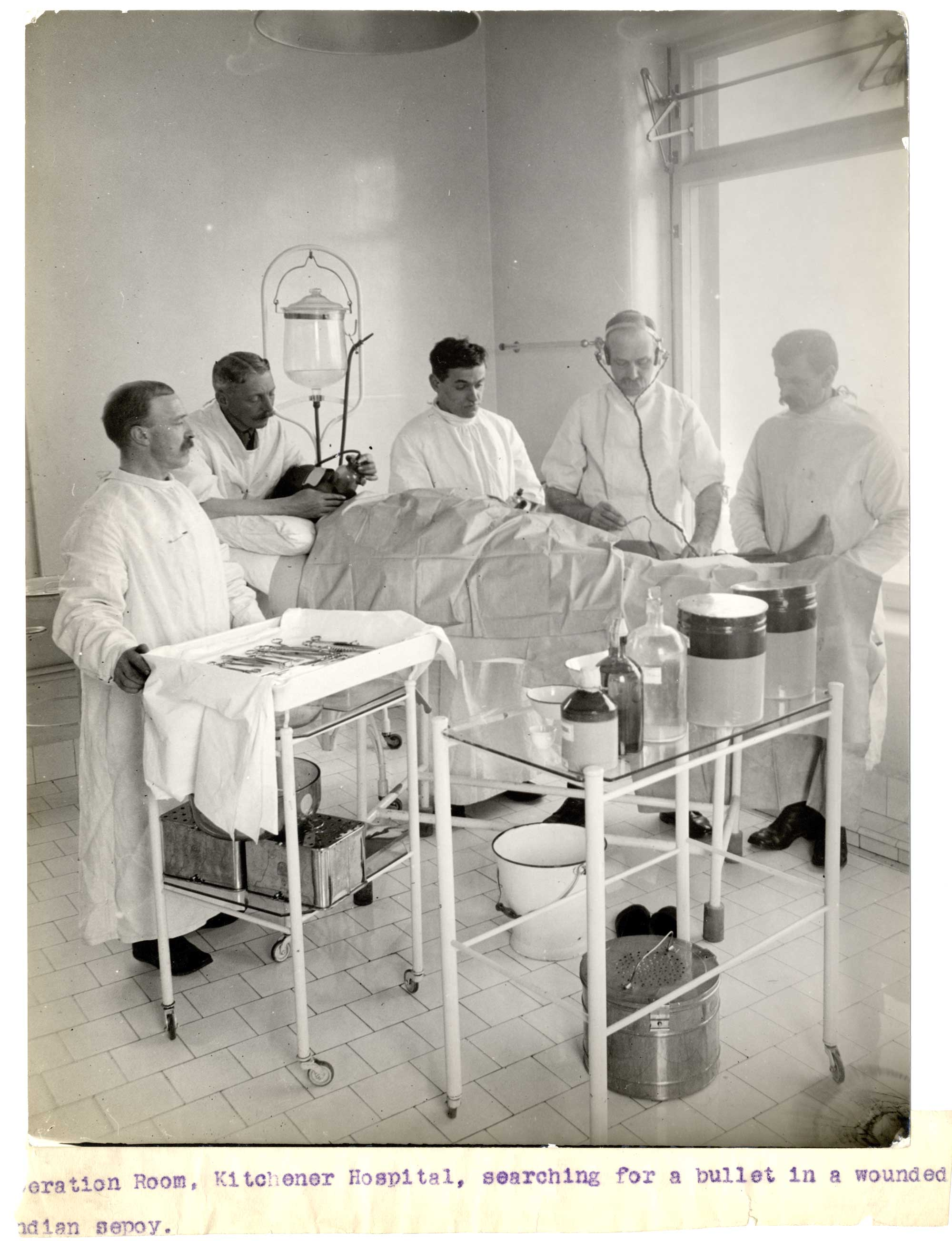 An operation is performed on a wounded Indian soldier, at the Kitchener Indian Hospital, in Brighton.