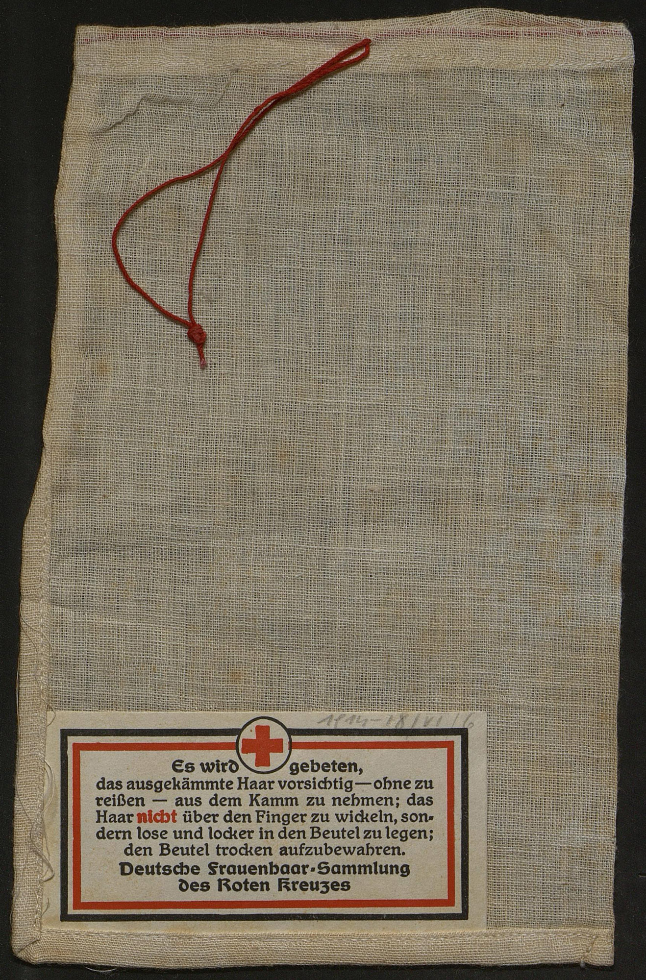 Example of a collection bag for women's hair from the Red Cross in Germany. At a time when raw materials were scarce, the hair was used to produce transmission belts.
